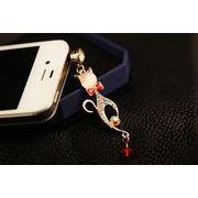 蝶ネクタイをした猫のイヤホンジャック キラキラネコ携帯アクセサリー ねこスマホアクセサリー